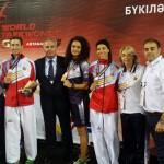 Eva Calvo junto al Presidente de la Real Federación Española de Taekwondo D. Jesús Castellanos, el equipo técnico y los competidores Rosana Simón y Jose A. Rosillo, que consiguieron medallas de bronce.